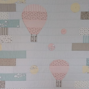 Balloon applique on baby quilt top