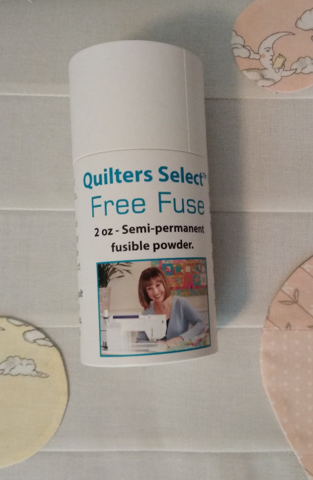 Free Fuse Semi Permanent fusible powerder for basting quilts or applique pieces.