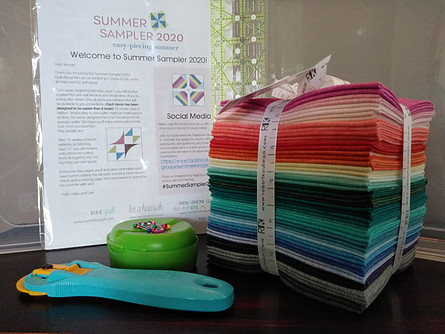 Welcome sheet, fabric and notions for summer sampler 2020 quilt top