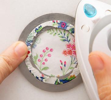 Ironing fabric using a Applipop template