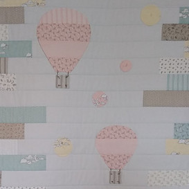 Up and Away baby quilt featuring hot air balloons and air bubbles