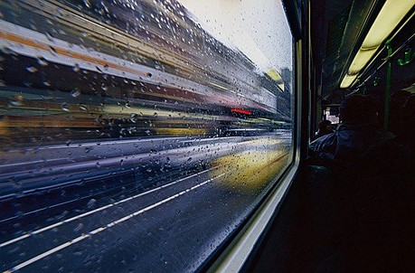 looking out a window on a fast moving train