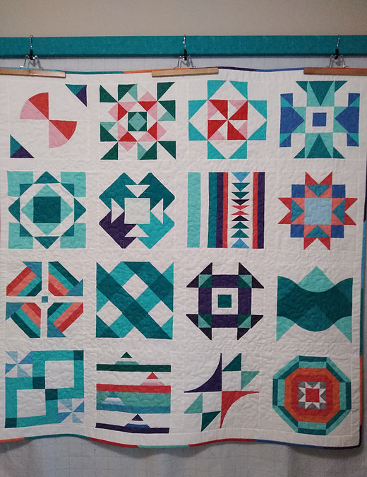 Summer Sampler 2020 quilt hanging from top of new design wall