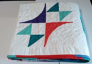 Summer Sampler quilt featuring Zephyr block
