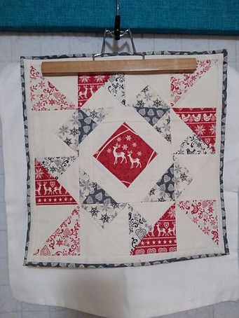 Quilt block made from the Scandi fabric line ready to be sewn onto ready-made zippered pillow case.
