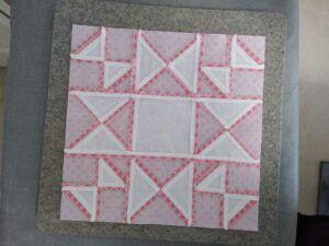 Underside of quilt block showing seams pressed open