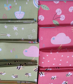 Pink and green fabric quarters from the Hello Sushine fabric line by Moda Fabrcs