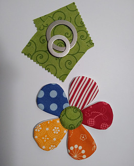 Applipop rings and fabric squares used to make the round flower center