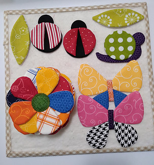 Applique lady bugs, butterflies, snail, leaves and flowers using Lori Holt's applique method (placed a design board using her instructions)