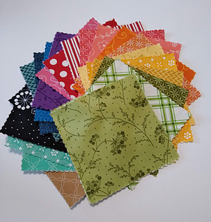 Multi colored fabric squares from Kimberbell Basics Spring charm pack